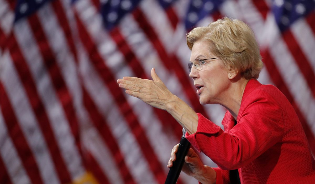 Warren suggests squeezing money from Justice Department to limit Trump interference
