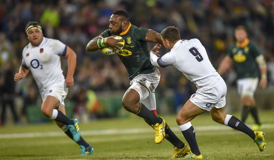 South Africa's Tendai Mtawarira runs with the ball as England's Ben Youngs makes a challenge during the second rugby test match between South Africa and England in Bloemfontein, South Africa, Saturday, June 16, 2018. (AP Photo/Christiaan Kotze)  **FILE**