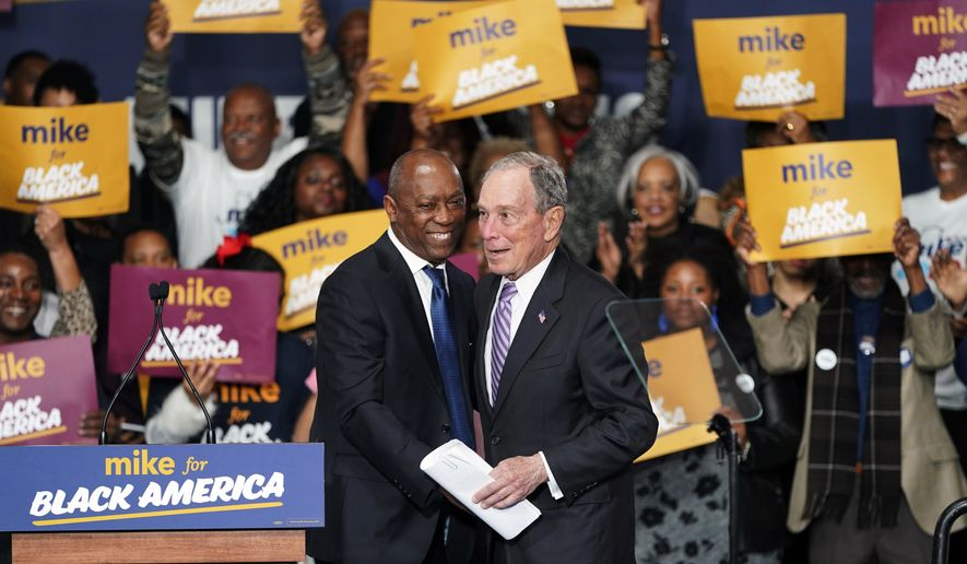 "Democratic presidential candidate and former New York City Mayor Michael Bloomberg, right, is introduced by Houston Mayor Sylvester Turner during his campaign launch of ""Mike for Black America,"" at the Buffalo Soldiers National Museum, Thursday, Feb. 13, 2020, in Houston. (AP Photo/David J. Phillip)"