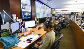Personnel at the The Centers for Disease Control and Prevention (CDC) work the Emergency Operations Center in response to the 2019 Novel Coronavirus, among other things, Thursday, Feb. 13, 2020, in Atlanta. (AP Photo/John Amis)