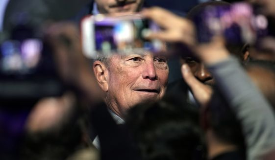 """Democratic presidential candidate and former New York City Mayor Michael Bloomberg poses for photographs with supporters during his campaign launch of """"Mike for Black America,"""" at the Buffalo Soldiers National Museum, Thursday, Feb. 13, 2020, in Houston. (AP Photo/David J. Phillip)"""