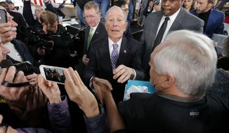 Democratic presidential candidate and former New York City Mayor Michael Bloomberg greets supporters after speaking at a campaign event in Raleigh, N.C., Thursday, Feb. 13, 2020. (AP Photo/Gerald Herbert)