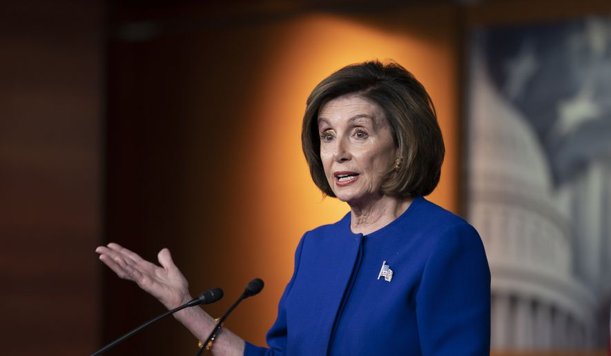 Speaker of the House Nancy Pelosi, D-Calif., talks to reporters just before the House vote to remove the deadline for ratification of the Equal Rights Amendment, on Capitol Hill in Washington, Thursday, Feb. 13, 2020. (AP Photo/J. Scott Applewhite)