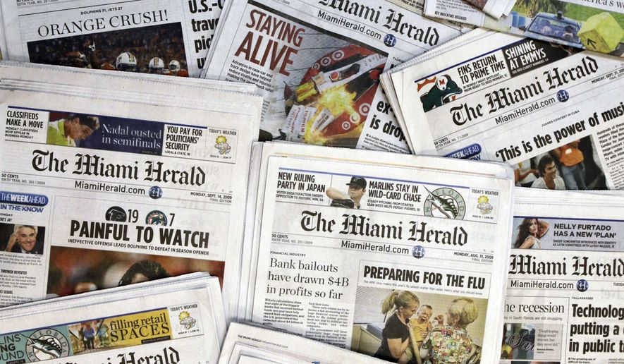 This Oct. 14, 2009, file photo, shows copies of the McClatchy Co. owned Miami Herald newspaper in Miami. McClatchy Co., the publisher of the Miami Herald, The Kansas City Star and dozens of other newspapers across the country is filing for bankruptcy protection. McClatchy Co. said Thursday, Feb. 13, 2020, that it will continue to run normally as it pursues approval of its restructuring plan under Chapter 11.  (AP Photo/Wilfredo Lee, File)
