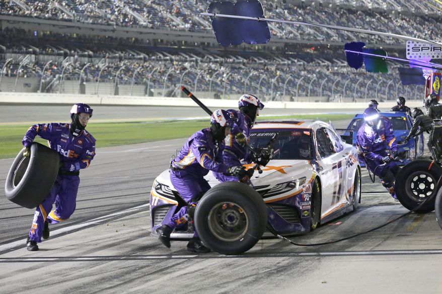 Denny Hamlin comes in for a pit stop during the first of two NASCAR Daytona 500 qualifying auto races at Daytona International Speedway, Thursday, Feb. 13, 2020, in Daytona Beach, Fla. (AP Photo/Terry Renna)