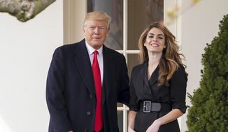In this March 29, 2018, file photo, President Donald Trump poses for members of the media with then-White House Communications Director Hope Hicks on her last day before he boards Marine One on the South Lawn of the White House in Washington. (AP Photo/Andrew Harnik) ** FILE **