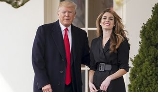 In this March 29, 2018 file photo, President Donald Trump poses for members of the media with then-White House Communications Director Hope Hicks on her last day before he boards Marine One on the South Lawn of the White House in Washington. Hicks, one of President Donald Trump's most trusted and longest-serving aides, is returning to the White House. Hicks will be serving as counselor to the president, working with presidential son-in-law and senior adviser Jared Kushner.  (AP Photo/Andrew Harnik) **FILE**