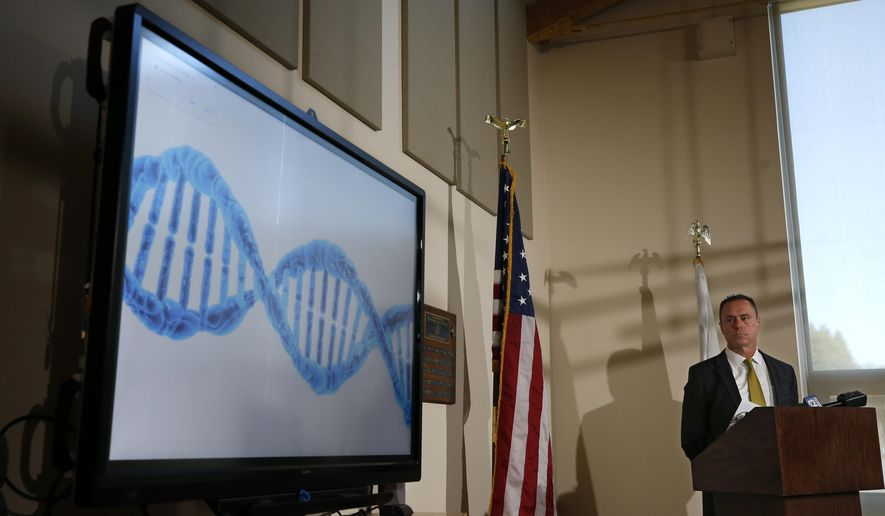 ADDS GENERIC - El Dorado County District Attorney Vern Pierson displays a generic genetic DNA ribbon as he discusses how new DNA evidence was used to help exonerate a man who spent about 15 years in prison after being wrongly convicted of killing his housemate, during a news conference in Placerville, Calif., Thursday, Feb. 13, 2020. Ricky Davis was convicted in 2004 of second degree murder in the stabbing death of a newspaper columnist. But the conviction was thrown out after new evidence was found implicating another person. (AP Photo/Rich Pedroncelli)