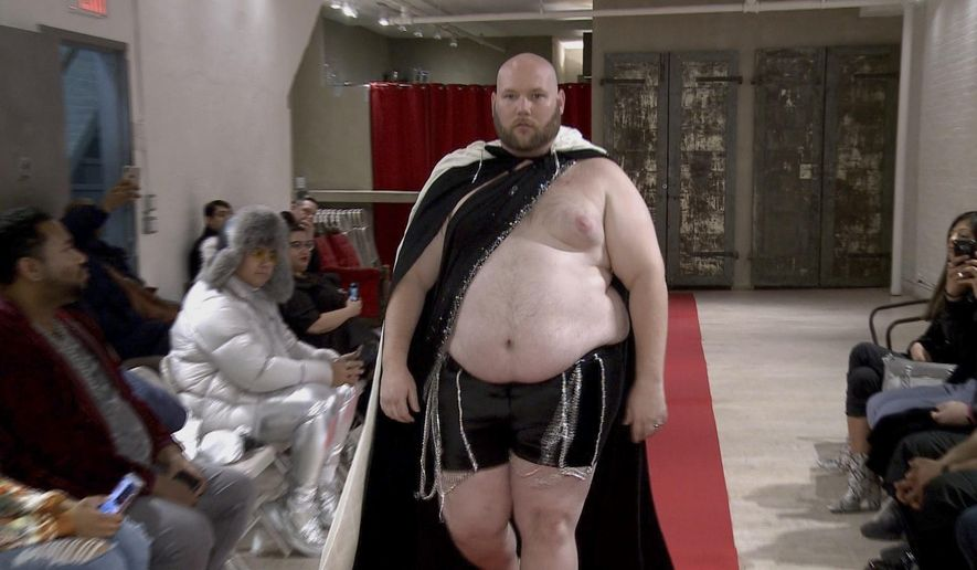 Joseph Diaz walks the runway in a fashion show Wednesday, Feb. 12, 2020, aimed at shining a light on male body shaming issues and the importance of the male body positivity movement. (AP Photo/Aron Ranen)