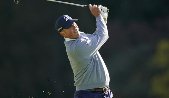 Matt Kuchar hits his second shot on the 13th hole during the first round of the Genesis Invitational golf tournament at Riviera Country Club, Thursday, Feb. 13, 2020, in the Pacific Palisades area of Los Angeles. (AP Photo/Ryan Kang)
