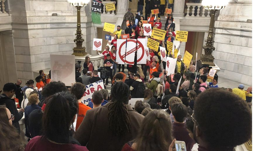 Gun control advocates and gun rights supporters attend a rally led by student activists at Rhode Island's Statehouse on Thursday, Feb. 13, 2020, in Providence, R.I. They gathered to call for gun reform and mark Friday's two-year anniversary of the deadly mass shooting at Parkland's Marjory Stoneman Douglas High School in Florida. The rally was held immediately after the state's Democratic governor and attorney general held an event to push state lawmakers to pass a group of bills they think would help curb gun violence. (AP Photo/Jennifer McDermott)