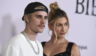 "Justin Bieber and Hailey Baldwin arrive at the Los Angeles premiere of ""Justin Bieber: Seasons,"" Monday, Jan. 27, 2020. (Photo by Jordan Strauss/Invision/AP) ** FILE **"