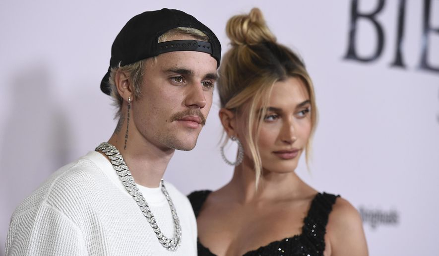 """Justin Bieber and Hailey Baldwin arrive at the Los Angeles premiere of """"Justin Bieber: Seasons,"""" Monday, Jan. 27, 2020. (Photo by Jordan Strauss/Invision/AP) ** FILE **"""
