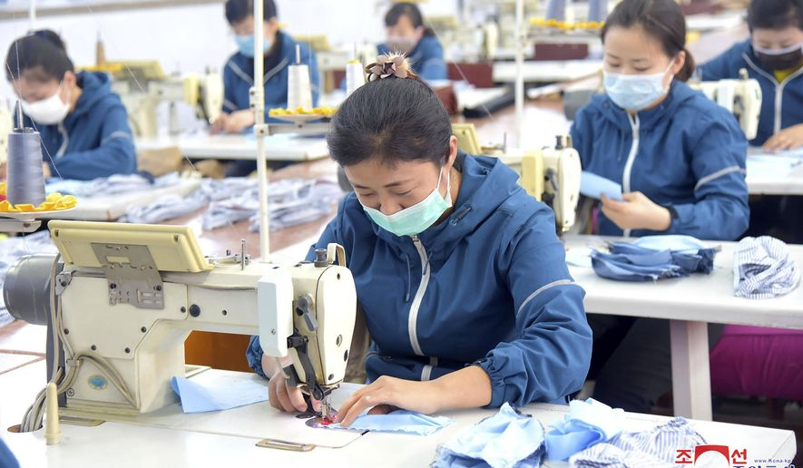"In this undated photo distributed on Friday, Feb. 7, 2020, by the North Korean government, North Korean workers produce face masks to prevent infection of a new virus in Pyongyang, North Korea. Independent journalists were not given access to cover the event depicted in this image distributed by the North Korean government. The content of this image is as provided and cannot be independently verified. Korean language watermark on image as provided by source reads: ""KCNA"" which is the abbreviation for Korean Central News Agency. (Korean Central News Agency/Korea News Service via AP)"
