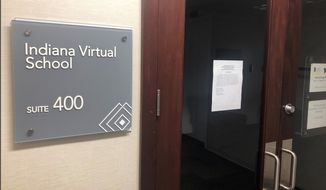 This Sept. 13, 2019, photo shows the closed office of Indiana Virtual School, in Indianapolis, with a message to creditors taped to the door stating that it no longer had assets or bank accounts. A new state audit report said Indiana Virtual School and a sister online school inflated their enrollments by thousands of students and inappropriately paid nearly $86 million to companies linked to the schools' founder or his associates. (AP Photo/Tom Davies)