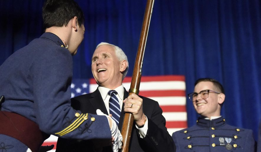 Vice President Mike Pence receives a musket as part of the Nathan Hale Patriot Award from The Citadel Republican Society on Thursday, Feb. 13, 2020, in Charleston, S.C. (AP Photo/Meg Kinnard)
