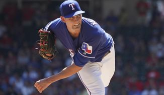 FILE - In this Sept. 26, 2019, file photo, Texas Rangers starting pitcher Mike Minor (23) throws against the Boston Red Sox during a baseball game in Arlington, Texas. All-Star lefty Mike Minor feels like the Texas Rangers will be in pretty good shape if he and hard-throwing right-hander Lance Lynn can again do what they did last season. (AP Photo/Louis DeLuca, File)