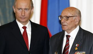 FILE - In this file photo taken on Tuesday, May 22, 2007, Russian President Vladimir Putin Putin, left, awards Russian intelligence veteran Alexei Botyan with the Hero of Russia award at the Moscow's Kremlin, Russia. Botyan, hailed for saving the Polish city of Krakow from being blown up by the Nazis during World War II, died Thursday Feb. 13, 2020, at the age of 103. (AP Photo/ Mikhail Metzel, Pool, File)