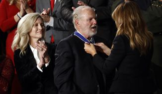 First lady Melania Trump presents the Presidential Medal of Freedom to Rush Limbaugh as his wife Kathryn watches during the State of the Union address to a joint session of Congress on Capitol Hill in Washington, Tuesday, Feb. 4, 2020. (AP Photo/Patrick Semansky)