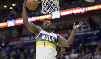 New Orleans Pelicans forward Zion Williamson grabs a rebound during the first half of the team's NBA basketball game against the Oklahoma City Thunder in New Orleans, Thursday, Feb. 13, 2020. (AP Photo/Matthew Hinton)