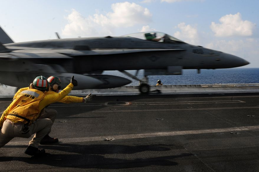 ARABIAN SEA(Nov. 25, 2012) Aircraft launch and recovery officers launch an F/A-18C Hornet assigned to the Wildcats of Strike Fighter Squadron (VFA) 131 from the flight deck of the Nimitz-class aircraft carrier USS Dwight D. Eisenhower. (U.S. Navy photo)