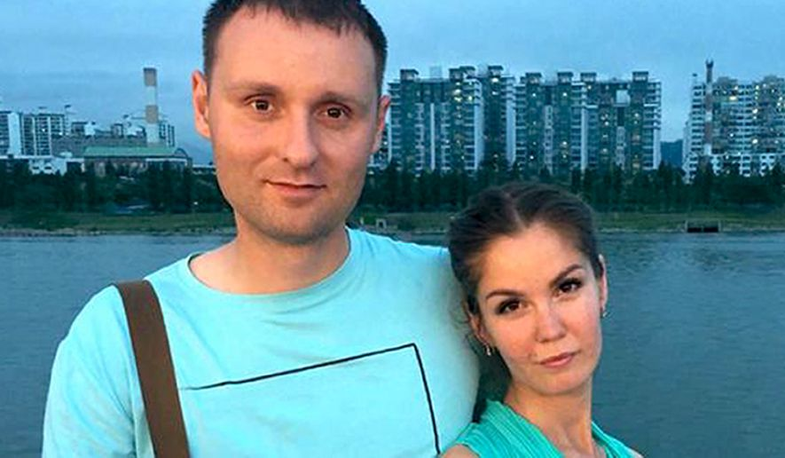 In this undated handout photo released by jw-russia.org, Vadim Kutsenko and his wife Ekaterina pose for a photo, in Seoul, South Korea. Police raided some 40 homes of Jehovah's Witnesses in Chita, a city in southern Siberia, and arrested four members of the group. One of them, Vadim Kutsenko, was beaten and tasered by men who identified themselves as officers of Russias National Guard, his lawyer Artur Ganin told The Associated Press. (jw-russia.org via AP)