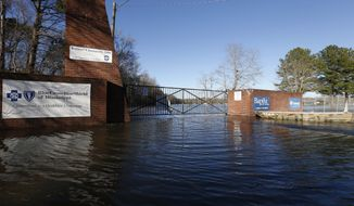 A soccer complex in northeast Jackson, Miss., Friday, Feb. 14, 2020, is underwater from flooding. As of Friday afternoon, the Pearl River was at 35.48 feet, which is more than 7 feet above flood stage.  (AP Photo/Rogelio V. Solis)