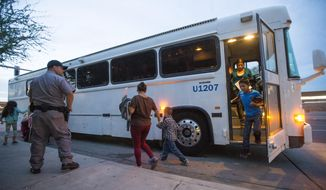 FILE - In this May 28, 2014, file photo, migrants are released from ICE custody at a Greyhound bus station in Phoenix. A Customs and Border Protection memo dated Jan. 28, 2020, obtained by The Associated Press confirms that bus companies such as Greyhound do not have to allow Border Patrol agents on board to conduct routine checks for illegal immigrants, despite the company's insistence that it has no choice but to do so. (Michael Chow/The Arizona Republic via AP, File)