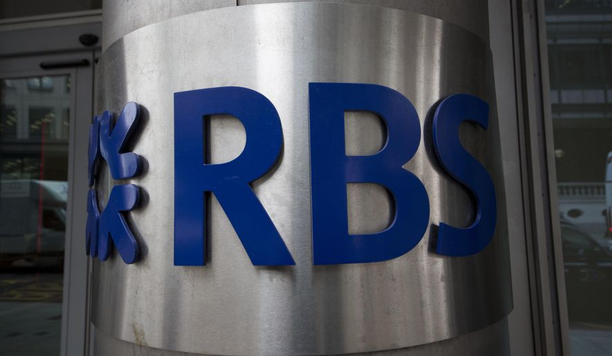 FILE - In this Thursday, Sept. 11, 2014 file photo, an exterior view of a Royal Bank of Scotland (RBS) logo at their offices in London. The majority state-owned U.K. bank RBS announced a name change on Friday, Feb. 14, 2020 as it tries to leave behind its near-collapse during the 2008 financial crisis. The bank said it will now be known as NatWest Group PLC, shedding the 300-year-old Royal Bank of Scotland name. (AP Photo/Matt Dunham, file)