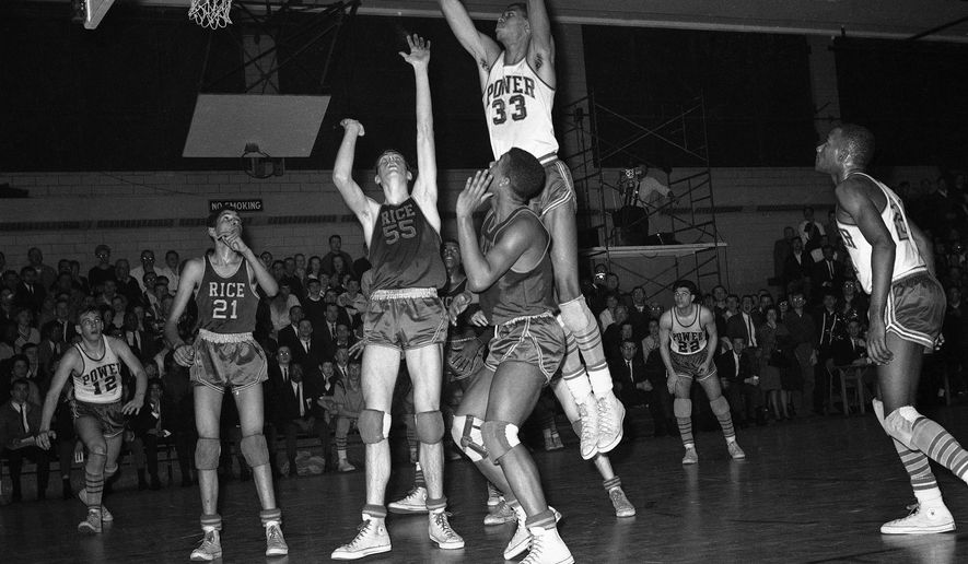 FILE - In this Feb. 11, 1965, file photo, Power Memorial player Lew Alcindor (33) leaps high for the ball during a high school basketball game against Rice at Power Memorial Gym in New York. (AP Photo/Harvey Lippman, File)