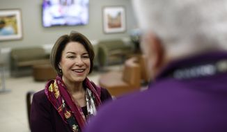 Democratic presidential candidate Sen. Amy Klobuchar, D-Minn., tours the Culinary Health Center, Friday, Feb. 14, 2020, in Las Vegas. (AP Photo/Patrick Semansky)