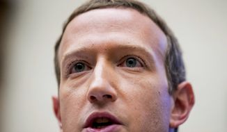 In this Wednesday, Oct. 23, 2019 file photo, Facebook CEO Mark Zuckerberg testifies before a House Financial Services Committee hearing on Capitol Hill in Washington on Facebook's impact on the financial services and housing sectors. (AP Photo/Andrew Harnik, File)