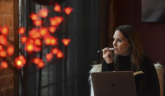 Professional matchmaker Erica Suzanne Fultz works at the Hotel Crosby in Stillwater, Minn. on Jan. 15, 2020. Her company, Erica Suzanne Fultz, specializes in matching men and women in their 40s and 50s. (Jean Pieri/Pioneer Press via AP)