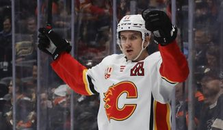 Calgary Flames center Mikael Backlund celebrates after scoring against the Anaheim Ducks during the first period of an NHL hockey game in Anaheim, Calif., Thursday, Feb. 13, 2020. (AP Photo/Chris Carlson)