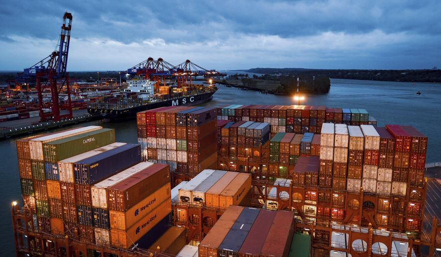 File---Picture taken October 4, 2017 shows containers on a cargo ship in Hamburg, Germany. (Axel Heimken/dpa via AP)