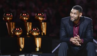 In this Dec. 18, 2016, file photo, San Antonio Spurs' Tim Duncan listens while special guests speak about him during his jersey retirement ceremony in San Antonio. Joining Kobe Bryant as first-time finalists for the Basketball Hall of Fame are: 15-time All-Star Duncan, fellow 15-time All-Star Kevin Garnett and 10-time WNBA All-Star and four-time Olympic gold medalist Tamika Catchings. (AP Photo/Darren Abate, File)  **FILE**