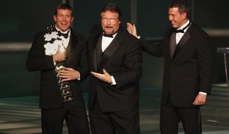 """FILE - In this March 27, 2010, file photo, WWE Superstar Ted DiBiase Jr., left, with brother Brett DiBiase, right, induct their father """"Million Dollar Man"""" Ted DiBiase into the 2010 WWE Hall of Fame at the Ceremony in Phoenix, Ariz. The state of Mississippi gave more than $2.1 million in federal welfare money to a ministry run by former pro wrestler Ted DiBiase Sr. He was known in the ring as """"The Million Dollar Man"""" and is the father of a Brett, who was recently indicted on charges of embezzling federal welfare money from the state.  (Rick Scuteri/AP Images for WWE, File)"""