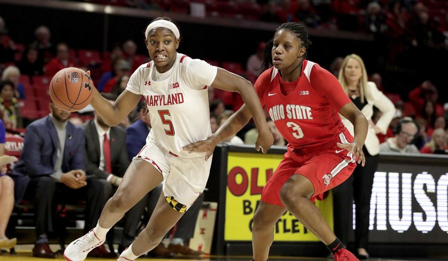 Maryland guard Kaila Charles (5) drives against Ohio State guard Janai Crooms (3) during the second half of an NCAA college basketball game, Monday, Jan. 6, 2020, in College Park, Md. Maryland won 72-62. (AP Photo/Julio Cortez) **FILE**