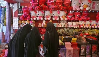 In this Thursday, Feb. 13, 2020 photo, women shop for Valentine's Day gifts in Najaf, Iraq. In recent years, Valentine's in Najaf has emerged as a field of contention. It pitted revelers who see in it harmless fun and personal freedom advocates against conservatives who view it as sacrilege--a foreign celebration that has no place in a holy city like Najaf. (AP Photo/Anmar Khalil)