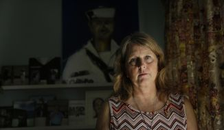 """Debbi Hixon, poses for a portrait on Friday, Feb. 14, 2020, in Hollywood, Fla. Hixon is the the widow of Parkland victim, Chris Hixon, a former athletic director and military veteran, killed in the school shooting on Valentine's Day two years ago at Marjory Stoneman Douglas High School. Her home was recently renovated by the program """"Military Makeovers."""" (AP Photo/Brynn Anderson)"""