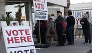 People wait in line at an early voting location at the culinary workers union hall, Saturday, Feb. 15, 2020, in Las Vegas. (AP Photo/John Locher)