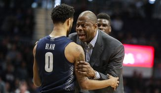 Georgetown head coach Patrick Ewing talks with guard Jahvon Blair (0) after an altercation between players in the second half of an NCAA college basketball game against Butler in Indianapolis, Saturday, Feb. 15, 2020. A double technical was called. Georgetown defeated Butler 73.66. (AP Photo/Michael Conroy)  **FILE**