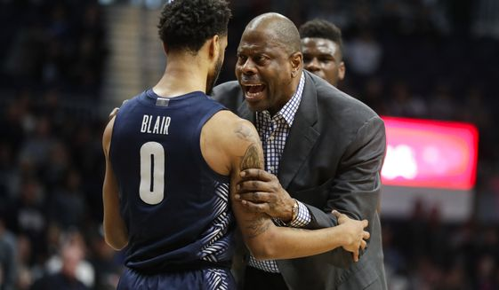 Georgetown head coach Patrick Ewing talks with guard Jahvon Blair (0) after an altercation between players in the second half of an NCAA college basketball game against Butler in Indianapolis, Saturday, Feb. 15, 2020. A double technical was called. Georgetown defeated Butler 73.66. (AP Photo/Michael Conroy)