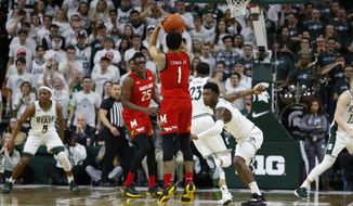 Maryland guard Anthony Cowan Jr. (1) shoots against Michigan State in the second half of an NCAA college basketball game in East Lansing, Mich., Saturday, Feb. 15, 2020. (AP Photo/Paul Sancya)