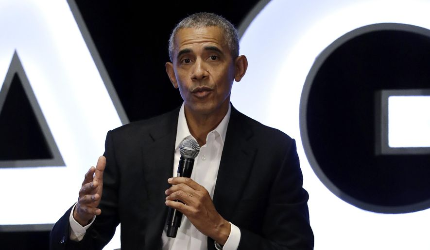 Former President Barack Obama talks during a panel with NBA players Chris Paul, Kevin Love and Giannis Antetokounmpo and sports analyst Michael Wilbon in Chicago on Saturday, Feb. 15, 2020. (AP Photo/Nam Y. Huh)