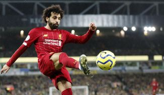 Liverpool's Mohamed Salah kicks the ball during the English Premier League soccer match between Norwich City and Liverpool at Carrow Road Stadium in Norwich, England, Saturday, Feb. 15, 2020. (AP Photo/Frank Augstein) ** FILE **