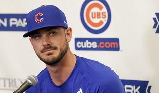 Chicago Cubs third baseman Kris Bryant speaks to reporters during spring training baseball Saturday, Feb. 15, 2020, in Mesa, Ariz. (AP Photo/Gregory Bull)