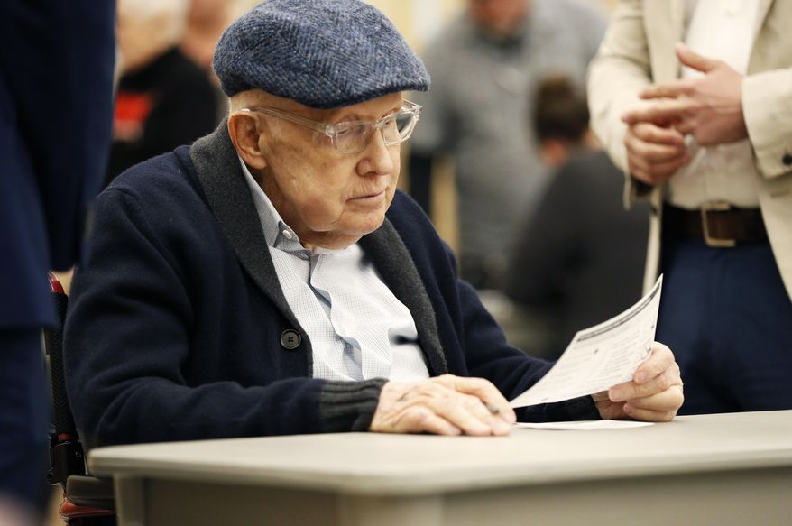 Former U.S. Sen. Harry Reid fills out his ballot at an early voting site at the East Las Vegas library, Saturday, Feb. 15, 2020, in Las Vegas. (AP Photo/John Locher)