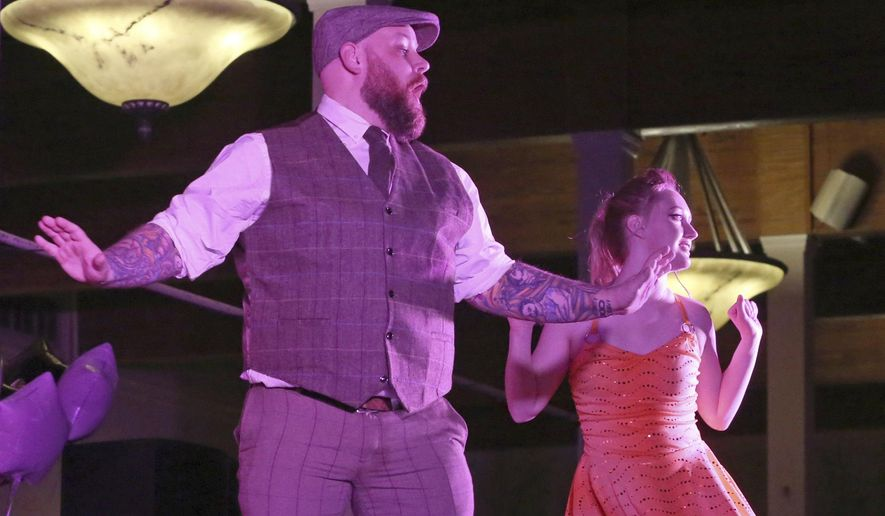 """In this Friday, Feb. 7, 2020, photo, Trent Lyons and Autumn Westhoff perform a swing dance at Dancing with the Local Stars at the Ambiance in Quincy, Ill. The event featured 14 local """"celebrity"""" couples trying to impress the judges and some 700 audience members while raising funds for Cornerstone: Foundation for Family, a nonprofit mental health counseling agency. (Katelyn Metzger/Quincy Herald-Whig via AP)"""