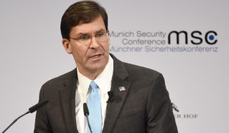 U.S. Secretary for Defense Mark Esper speaks on the second day of the Munich Security Conference in Munich, Germany, Saturday, Feb. 15, 2020. (AP Photo/Jens Meyer)